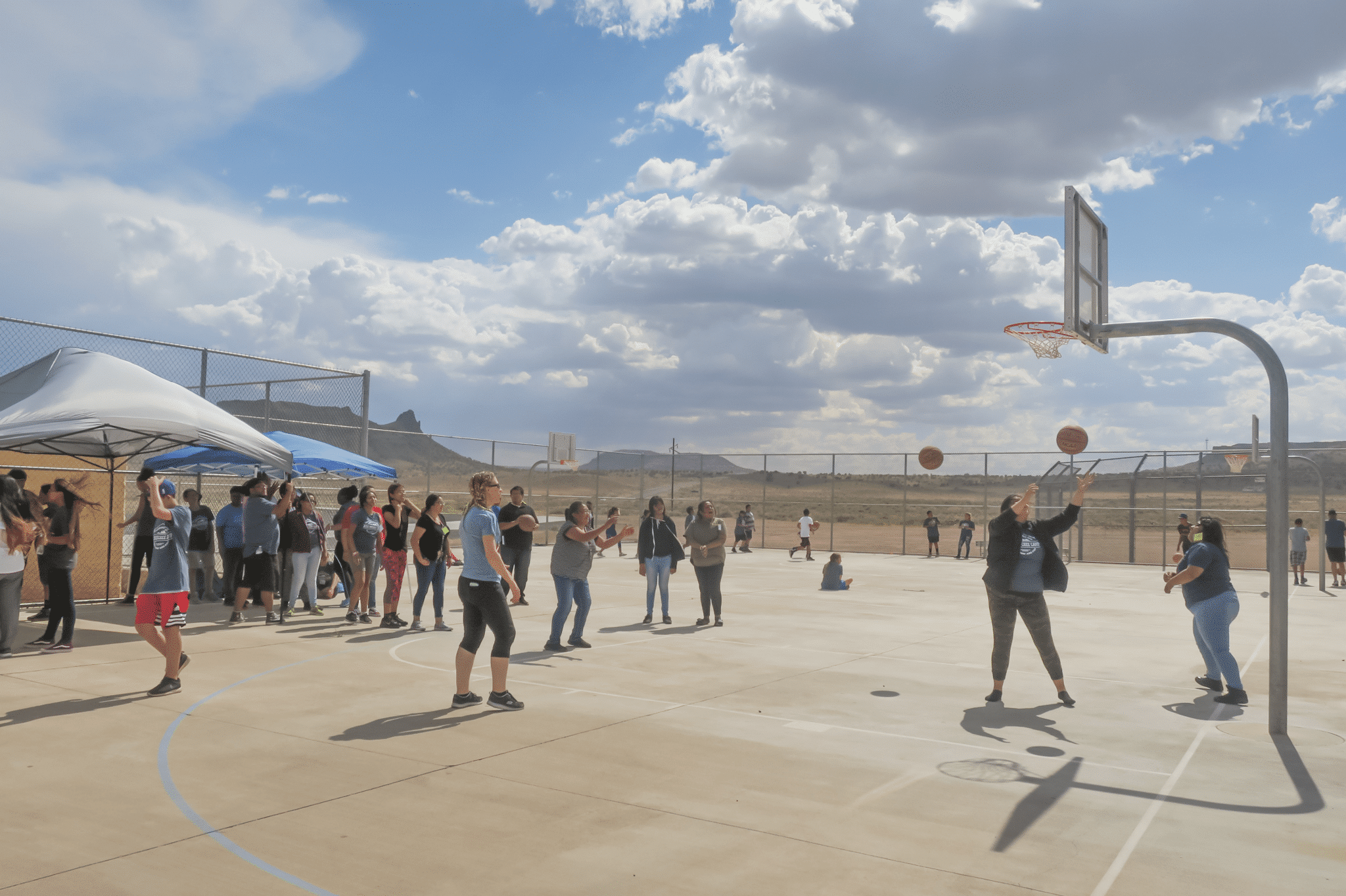 People playing basketball on the palyground