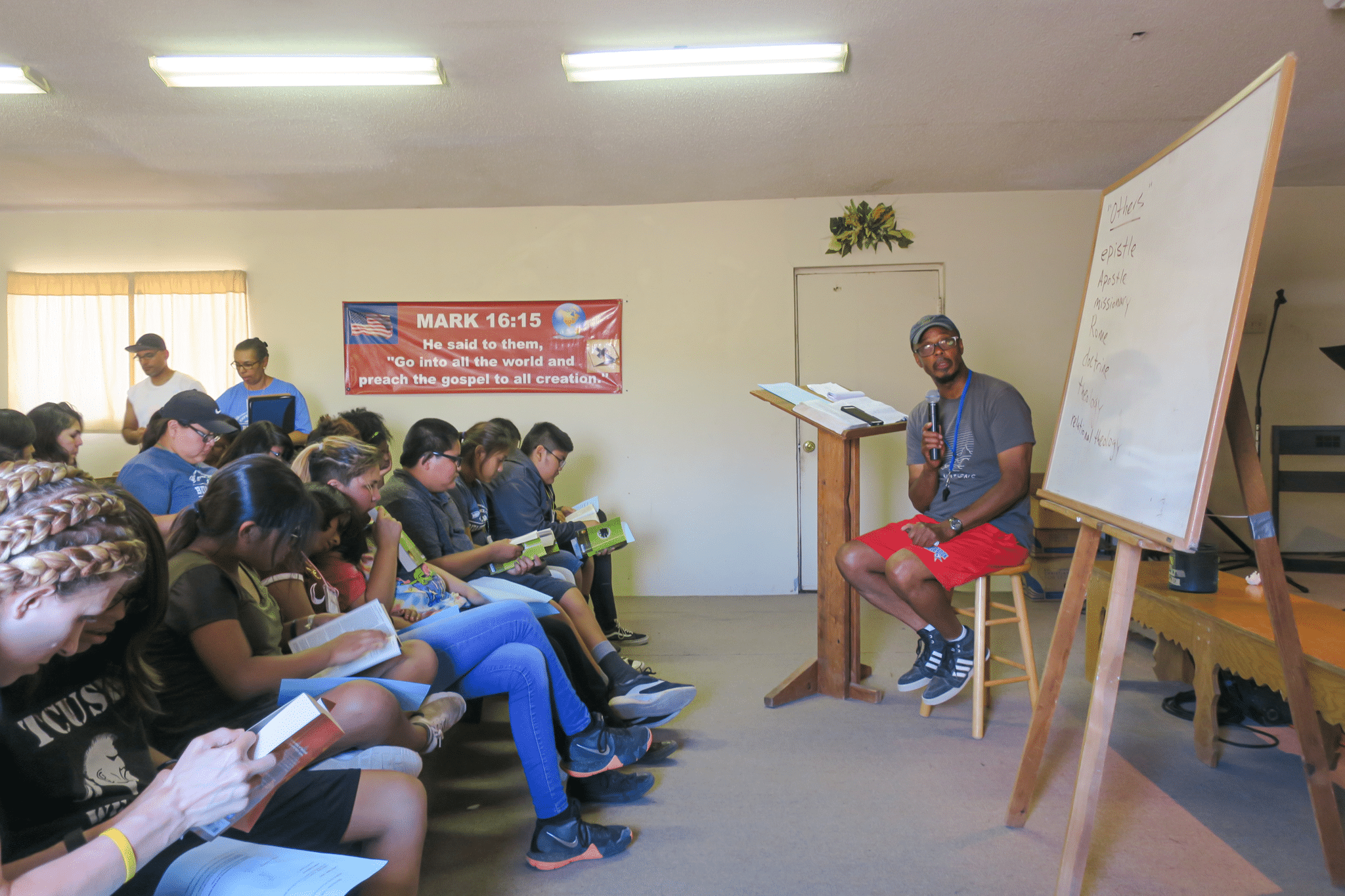 Pastor teaching youths in Navajo